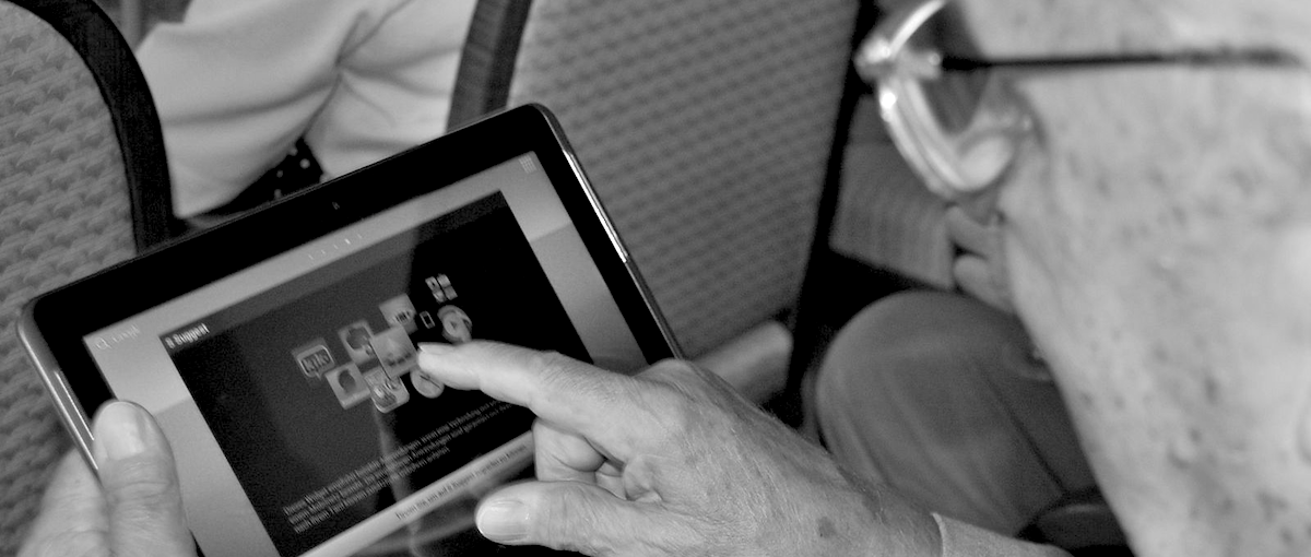 A senior citizen using a tablet computer.